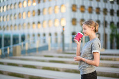 Young beautiful woman having her coffee break Royalty Free Stock Photography