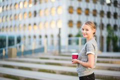 Young beautiful woman having her coffee break Stock Images