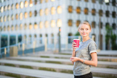 Young beautiful woman having her coffee break Stock Photography