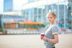 Young beautiful woman having her coffee break Royalty Free Stock Image