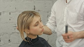 Young beautiful woman having her hair cut at the hairdresser's. stock video footage