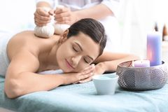 Young beautiful woman having massage Royalty Free Stock Images