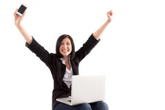 Young beautiful woman having online shopping, arms outstretched. Stock Image Stock Photo