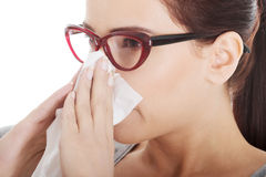 Young beautiful woman having runny nose, with tissue. Stock Photography