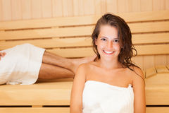 Sauna bath in a steam room. Young beautiful woman having a sauna bath in a steam room stock images