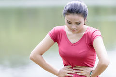 Young beautiful woman is having stomach ache Royalty Free Stock Images