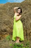 Young beautiful woman on hay Royalty Free Stock Photography