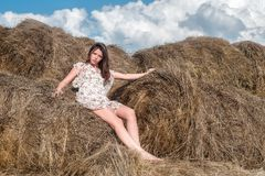 Young beautiful woman on hay Stock Photos