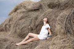 Young beautiful woman in the hayloft in the village Royalty Free Stock Images