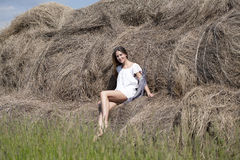 Young beautiful woman in the hayloft in the village Stock Image