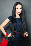 Young Beautiful Woman with Healthy Black Hair Stock Photo