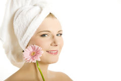 Young beautiful woman with healthy skin and flower Stock Photography