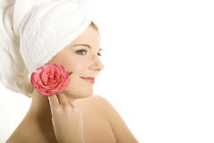 Young beautiful woman with healthy skin and flower Royalty Free Stock Photos