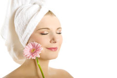 Young beautiful woman with healthy skin and flower Stock Photos