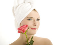 Young beautiful woman with healthy skin and flower Royalty Free Stock Image