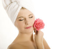 Young beautiful woman with healthy skin and flower Royalty Free Stock Photo