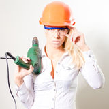 Young beautiful woman with helmet drill and glasses Stock Photography