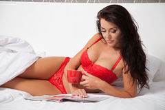 Young beautiful woman in her bed Stock Image