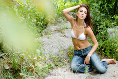 Young beautiful woman on her knees outdoor portrait Stock Photography