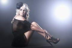 Young beautiful woman in high fashion dress stock photos