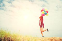 Young beautiful woman holding balloon very happy on the fresh ai stock photo