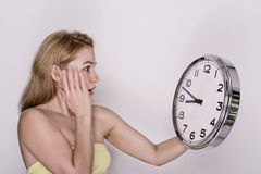 Young beautiful woman holding big clock. time concept. Royalty Free Stock Photography