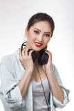 Young beautiful woman holding big headphones isolated white background Royalty Free Stock Photography