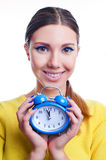Young beautiful woman holding big and small clocks Stock Photo