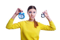 Young beautiful woman holding big and small clocks Stock Images