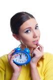 Young beautiful woman holding blue clocks Stock Photos