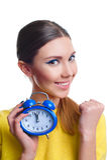 Young beautiful woman holding blue clocks Stock Photo