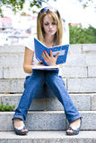 Young beautiful woman holding books Stock Photos