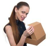 Young beautiful woman holding a box Stock Photo