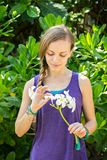 Girl with white flowers of plumeria Royalty Free Stock Photography