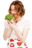 Young beautiful woman holding a broccoli Royalty Free Stock Images