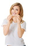 Young beautiful woman holding broken cigarette Royalty Free Stock Image