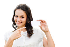 Young beautiful woman holding business card. With copy space isolated over white background Royalty Free Stock Image