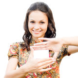 Young beautiful woman holding business card Stock Photo