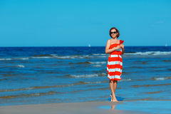 Young beautiful woman holding candy heart and enjoying summer beach vacation Royalty Free Stock Photos