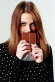 Young beautiful woman holding chocolate Stock Images