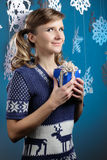 Young beautiful woman holding Christmas present looking at camera smiling. Royalty Free Stock Photo