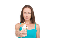 Young beautiful woman holding cigarette in front. Stock Images