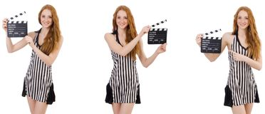 The young beautiful woman holding clapper-board. Young beautiful woman holding clapper-board royalty free stock images