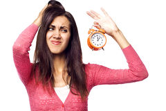Young beautiful woman holding a clock stock images