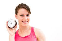 Young beautiful woman holding a clock Royalty Free Stock Photo