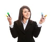 Young beautiful woman holding colorful highlighters. Isolated Royalty Free Stock Image