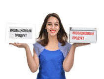 Young beautiful woman holding comparing two empty boxes happy sm Royalty Free Stock Photography