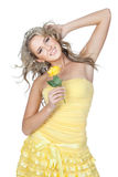 Young beautiful woman holding flower in her hands Stock Photography