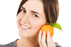 Young beautiful woman holding fresh tangerine Royalty Free Stock Photography