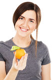 Young beautiful woman holding fresh tangerines Stock Photos